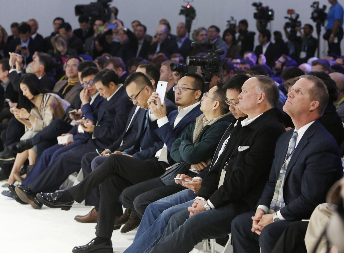 Invitees attend the Faraday Future (FF) FFZERO1 Concept vehicle reveal event at FF's pre-CES, in Las Vegas on Monday, Jan. 4, 2016. (Bizuayehu Tesfaye/ AP Images for Faraday Future)
